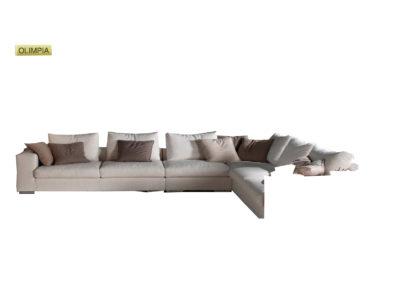 Salotto Olimpia di produzione artigianale composto da: divano 2/3 posti, elemento 2/3 posti, poltrona e pouf. Anche su misura. Realizzabile su tessuti indicati dal cliente.